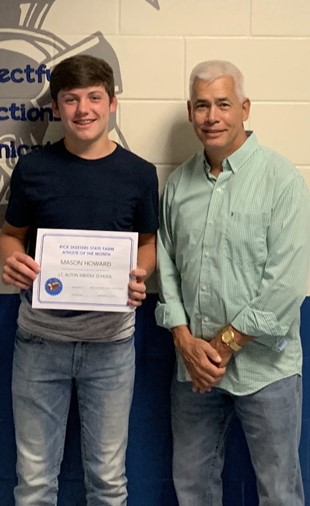 8th Grader, Mason Howard, JTA September Student Athlete of the Month, pictured here with Mr. Rick Skeeters.