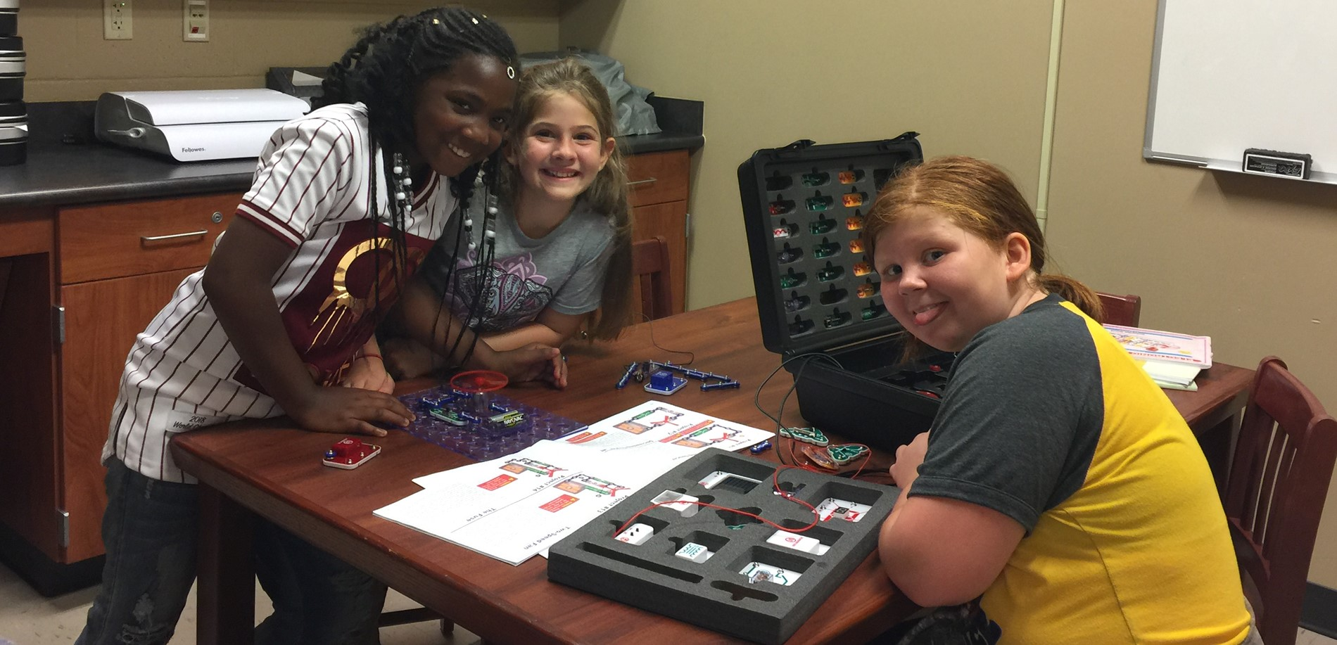 Radcliff Students work with circuits in the media center.