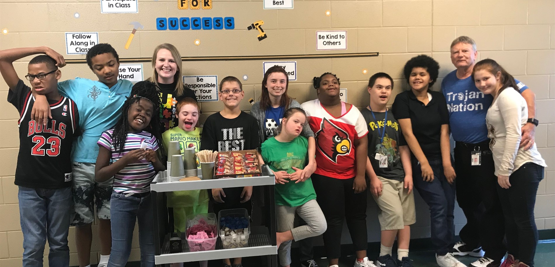 Miss Gallagher and her class with their Friday coffee cart.