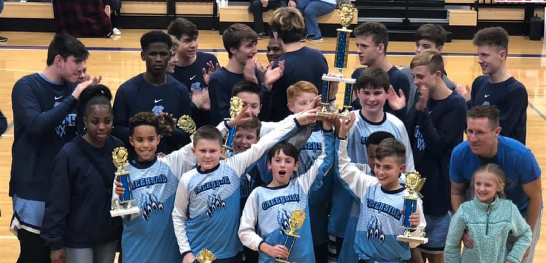 Creekside Bruins 5th grade boys basketball team holding their championship trophy.