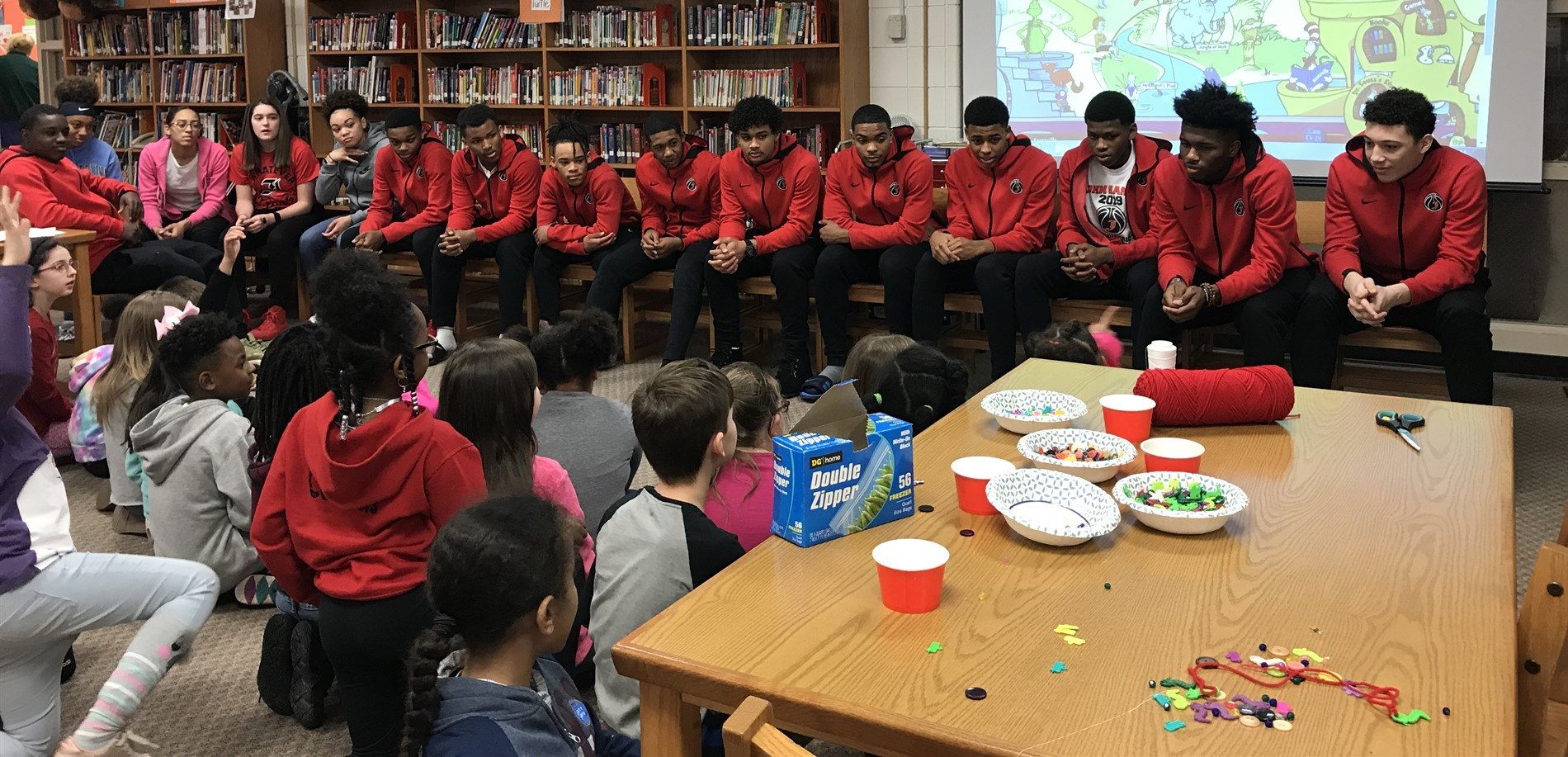 JHHS Boy and Girl Basketball Players talk to third grade and others about setting goals and working hard in school while also making Seuss crafts with them.