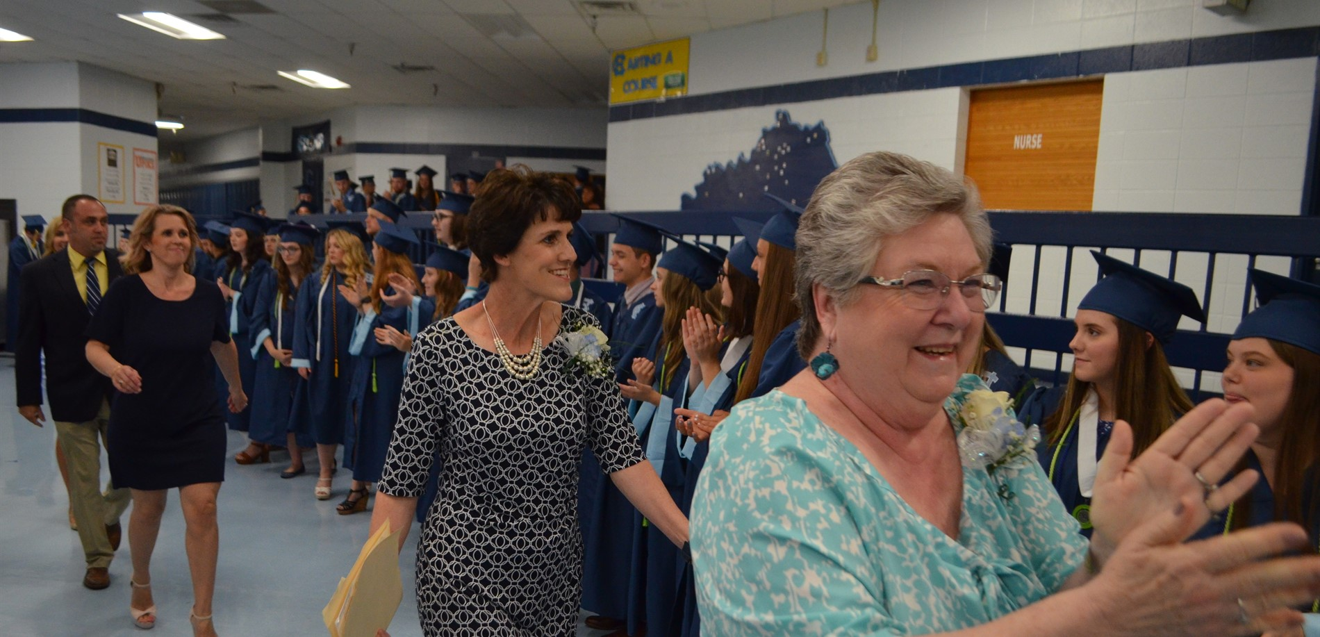 HCS Board Member Kay Sharon and Superintendent Teresa Morgan applauded graduates in their traditional