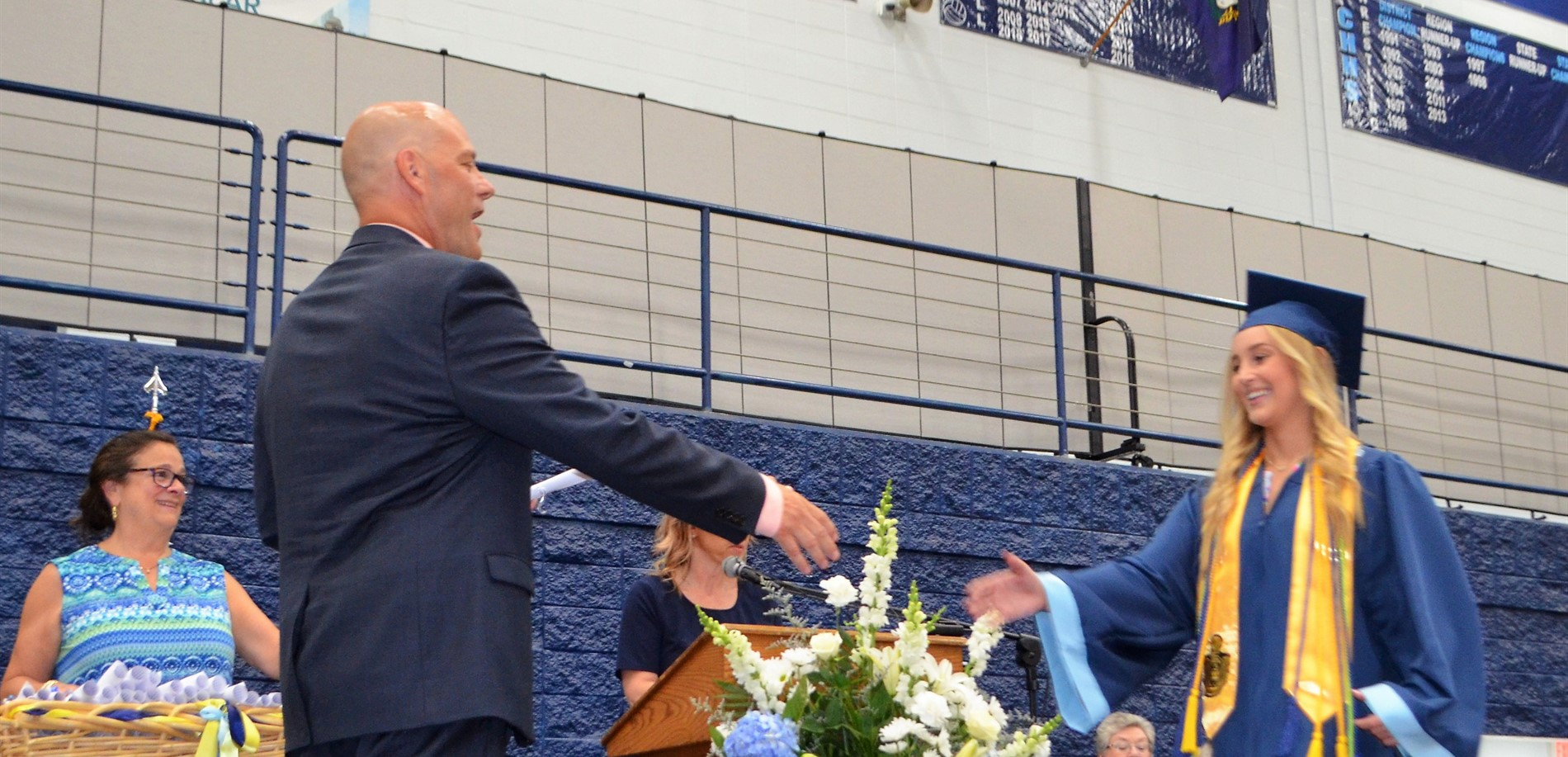 Central Hardin High School Principal Tim Isaacs greeted a graduate with her diploma and congratulations.