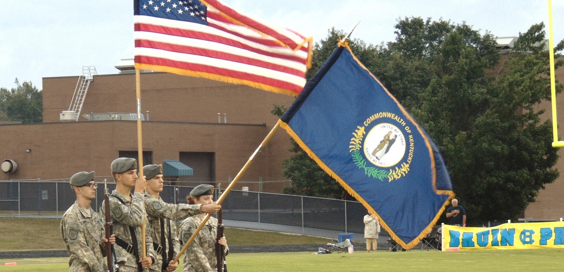 Junior ROTC Presents Flags at First Game of the Season