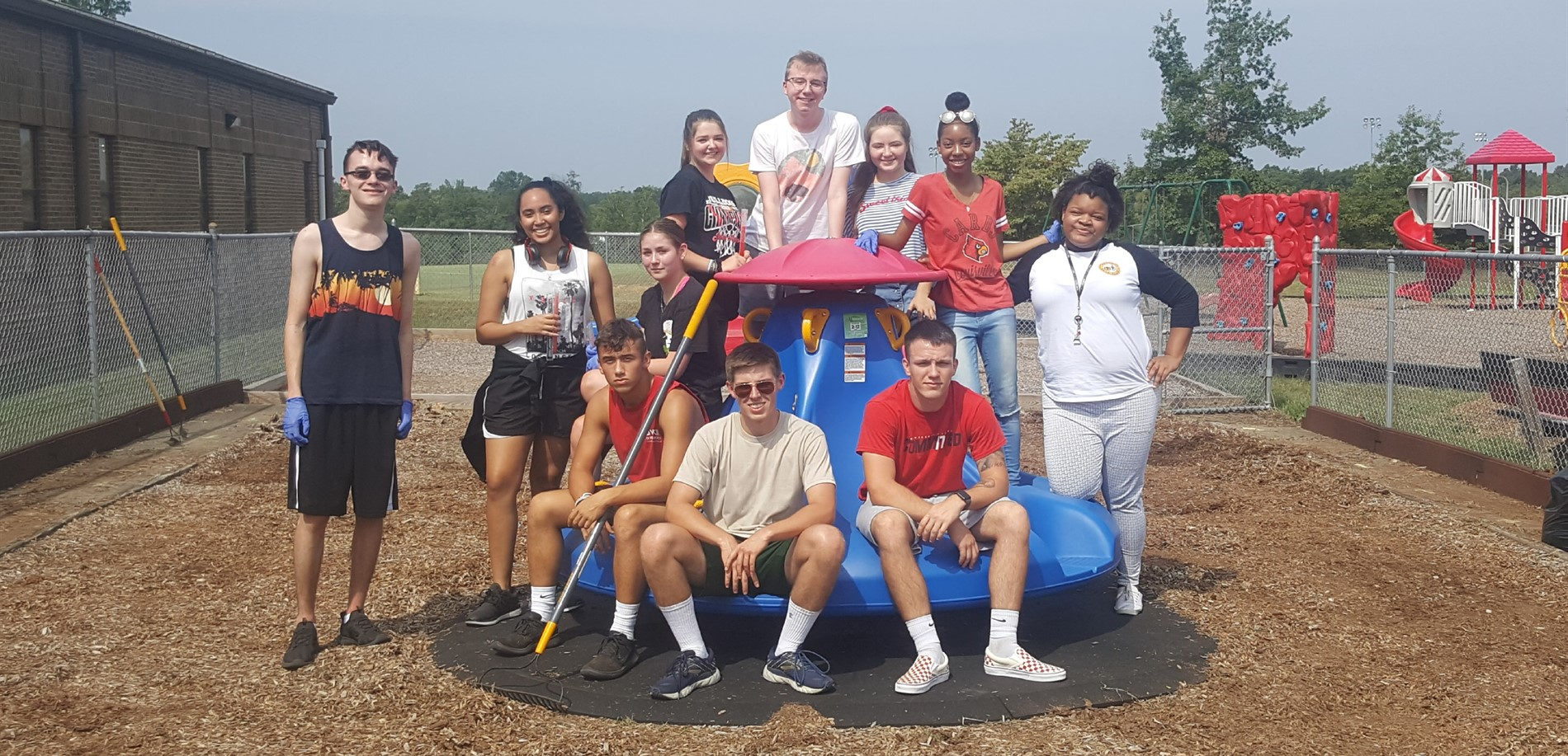 JHHS students mulch playground New Highland Elementary