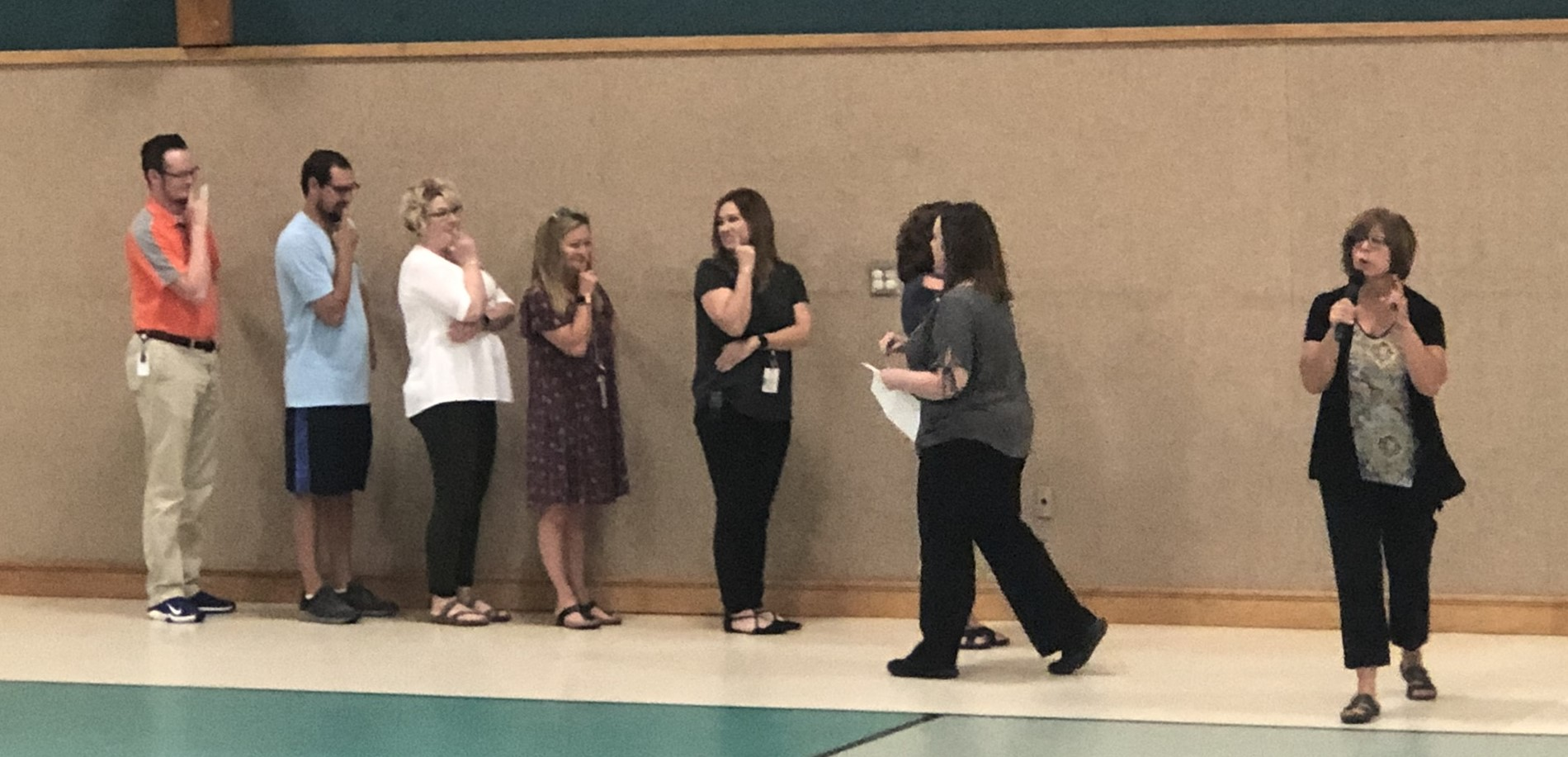 North Park teachers demonstrating expectations at PBIS assembly.