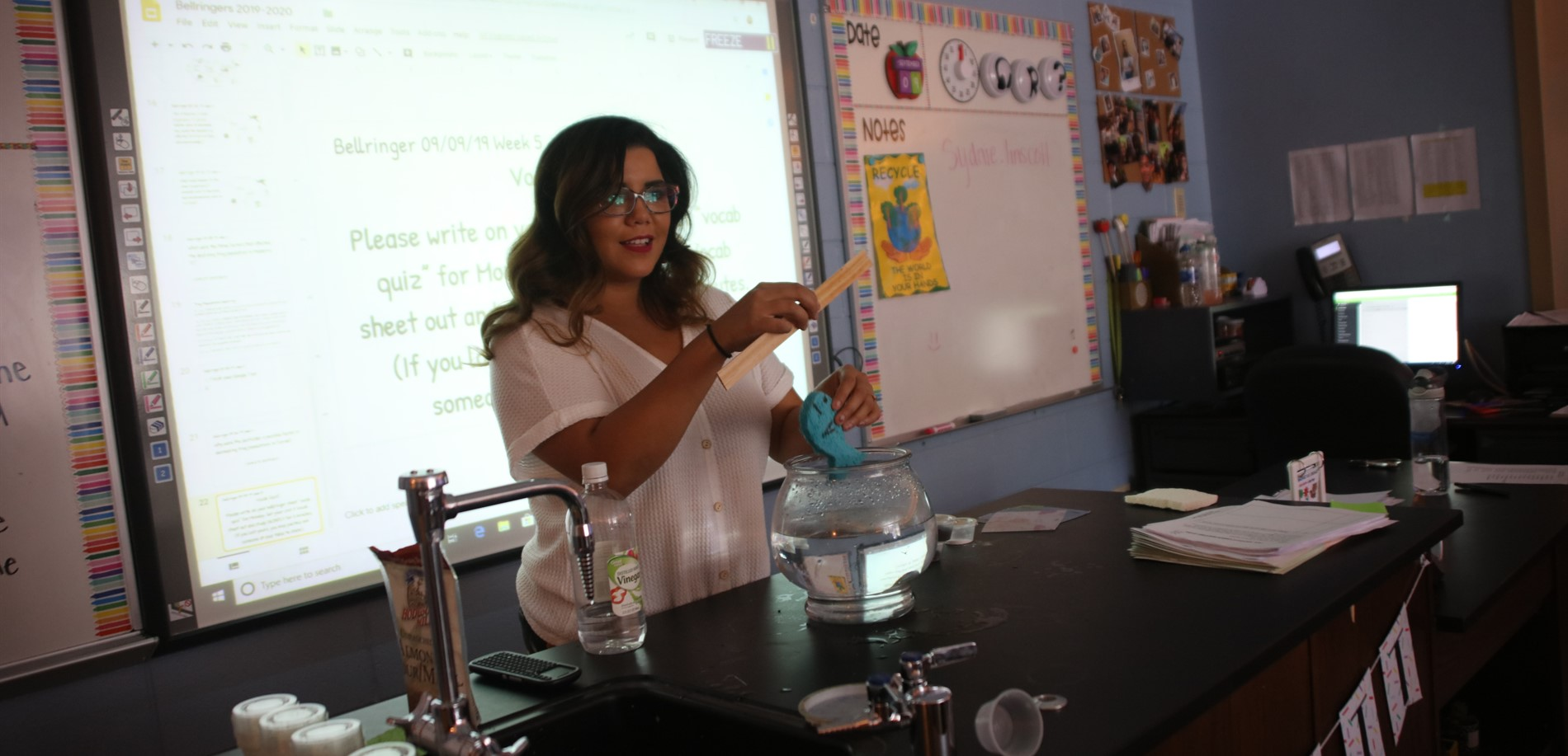 Mrs. Linscott introducing Freddie the Fish  (Class pet who will test water pollution)