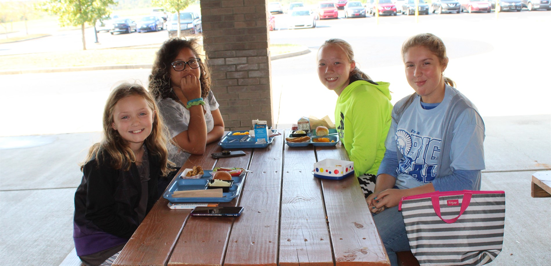 NMS Big Deals enjoying lunch at the picnic tables