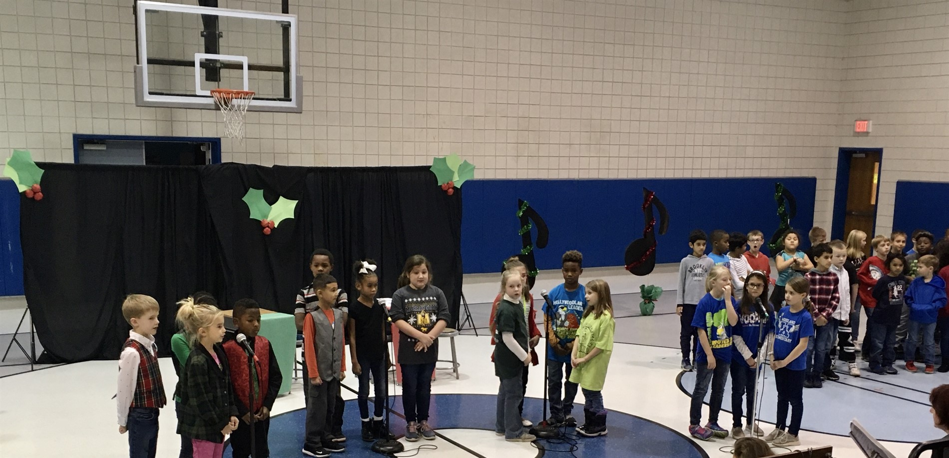 2nd and 3rd grade students sing in the holiday performance