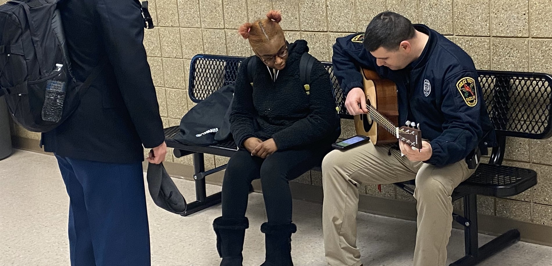 Officer Rossell, JHHS School Resource Officer, tuned a student's guitar at the end of the school day.