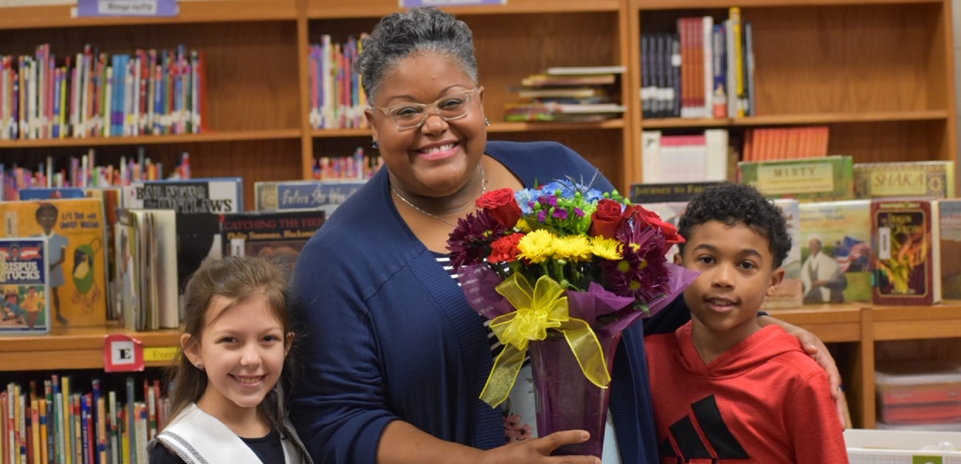 Student PTO Representatives present flowers to Ms. Roopchan
