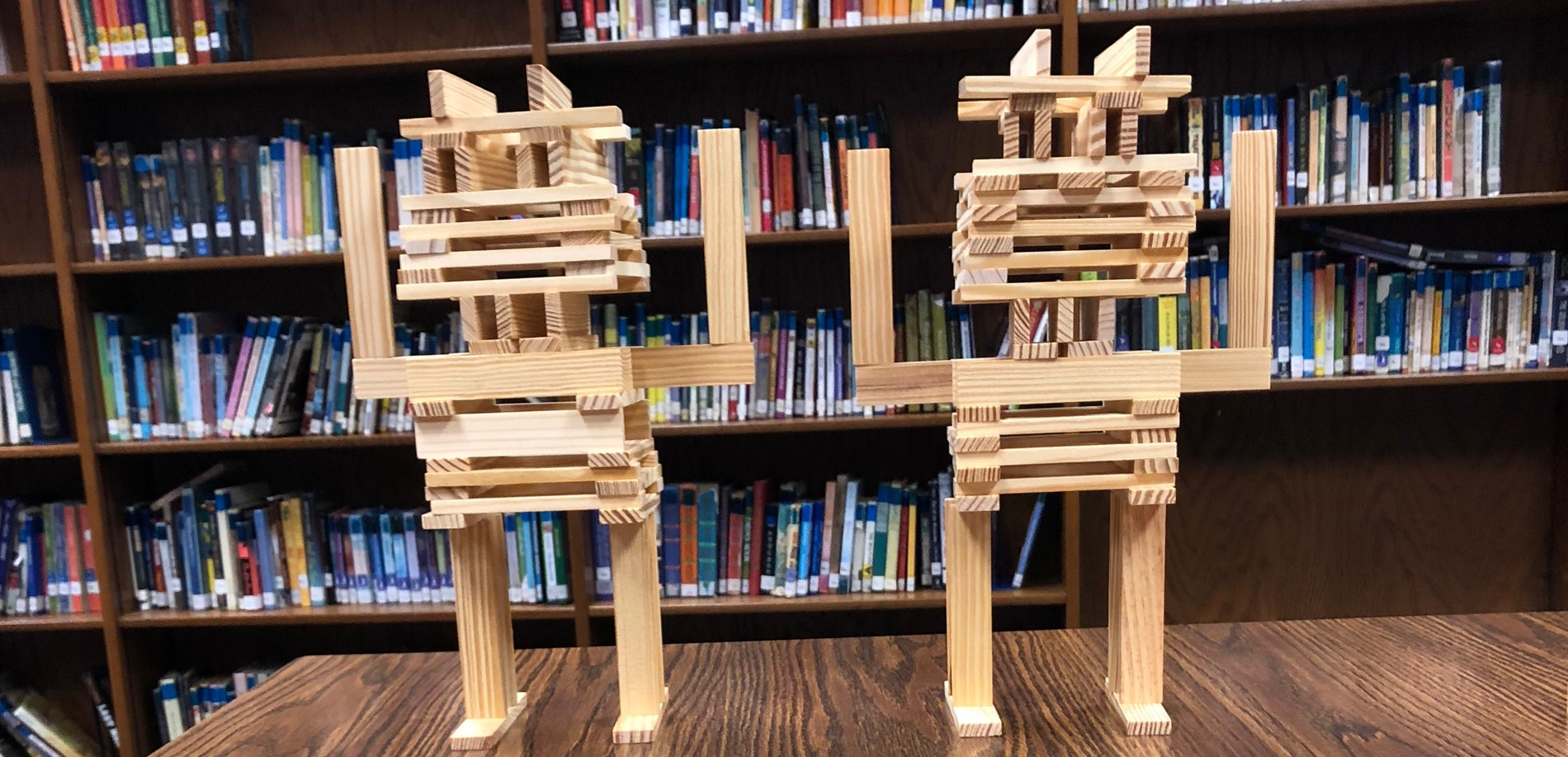 students used KEVA planks to build 2 structures that look like robots in our library media center makerspace.