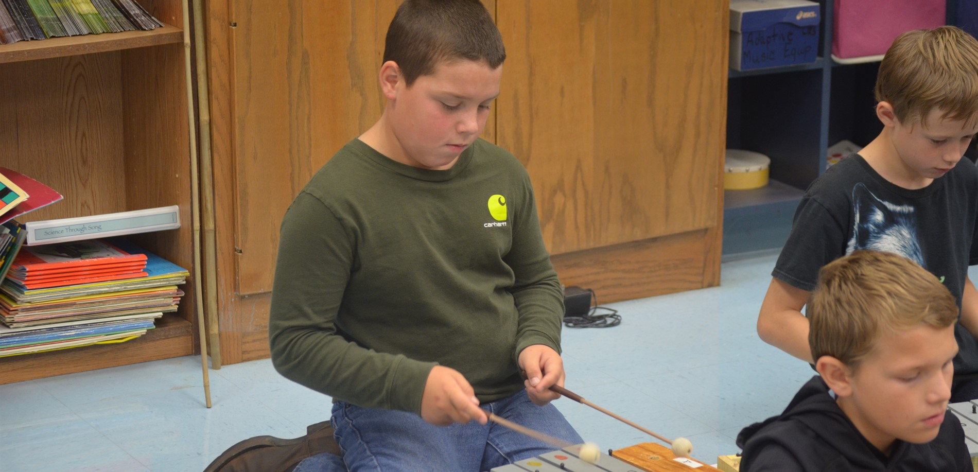 Student playing xylophone