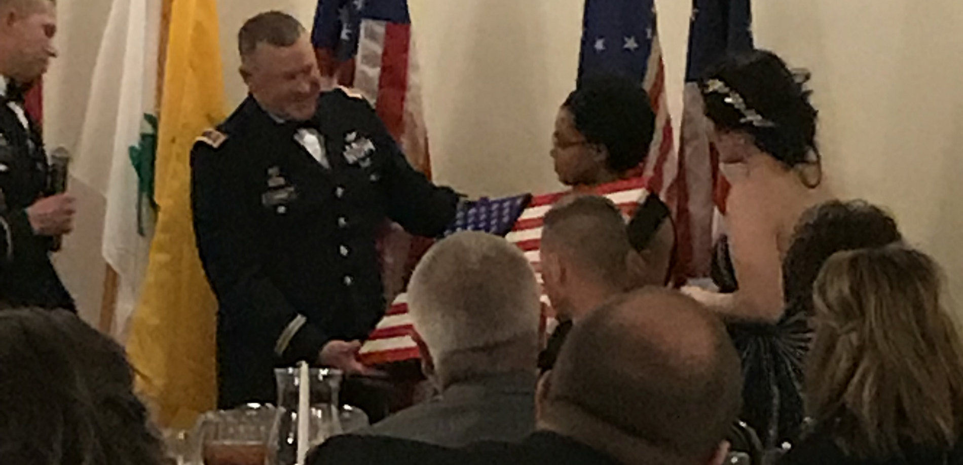 Major Fisher presented with wooden flag at Military Ball