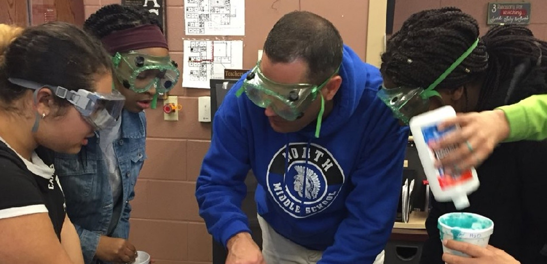 North Middle School students work with Principal Jeff Lowman to make slime in science class.