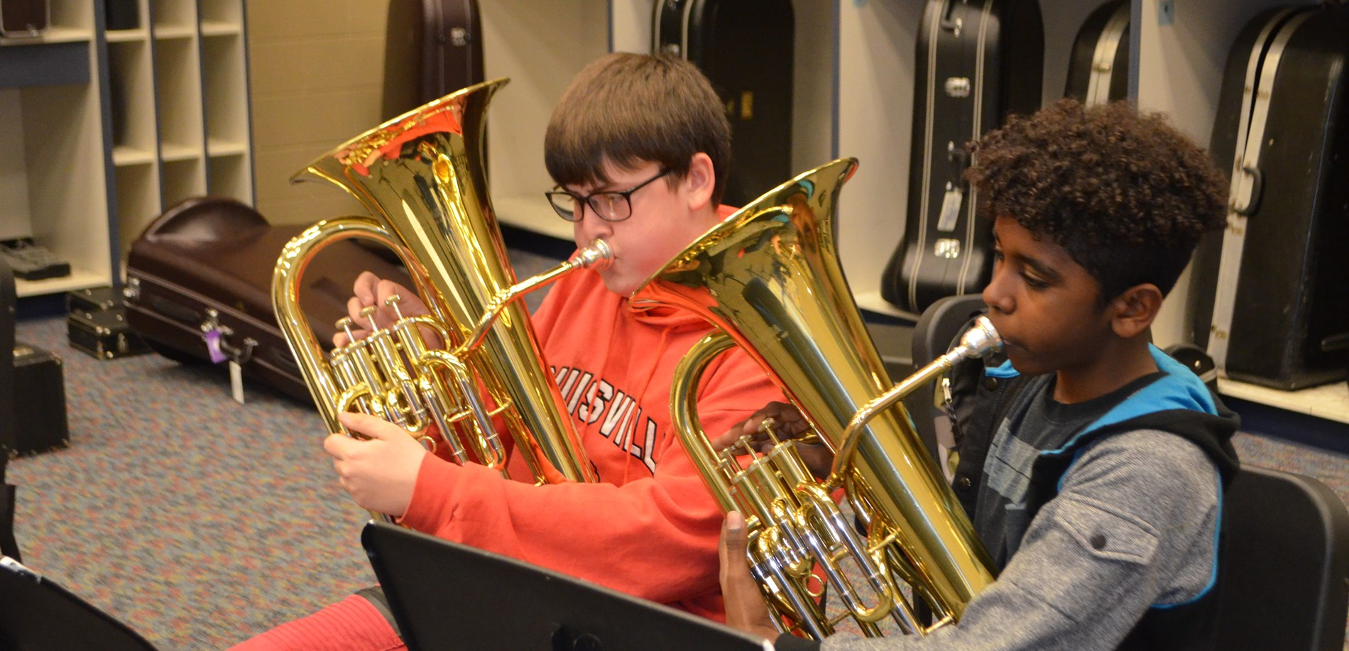 North Middle School music students practice baritone during band class.