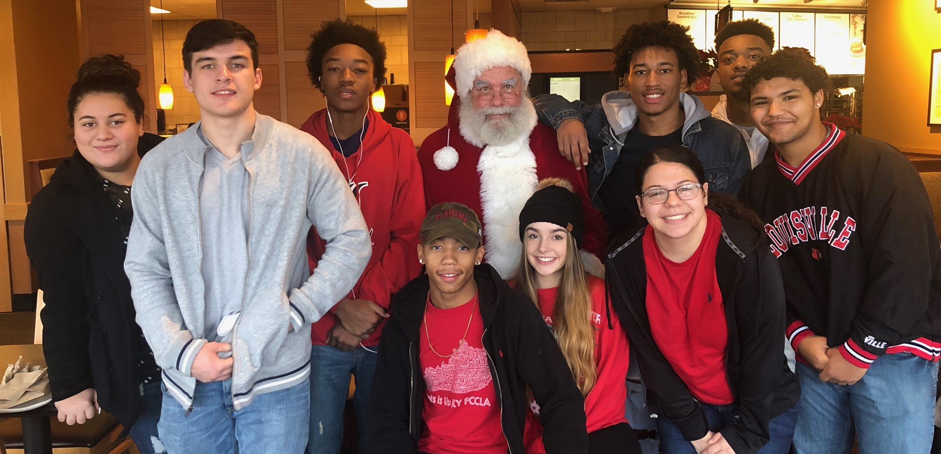 JHHS FCCLA members were visited by Santa before their morning of Salvation Army bell ringing.