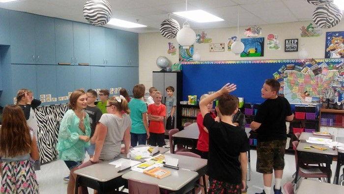 Fifth grade students use the Kagan strategy Hands Up, Pair Up to learn about one another the first week of school.