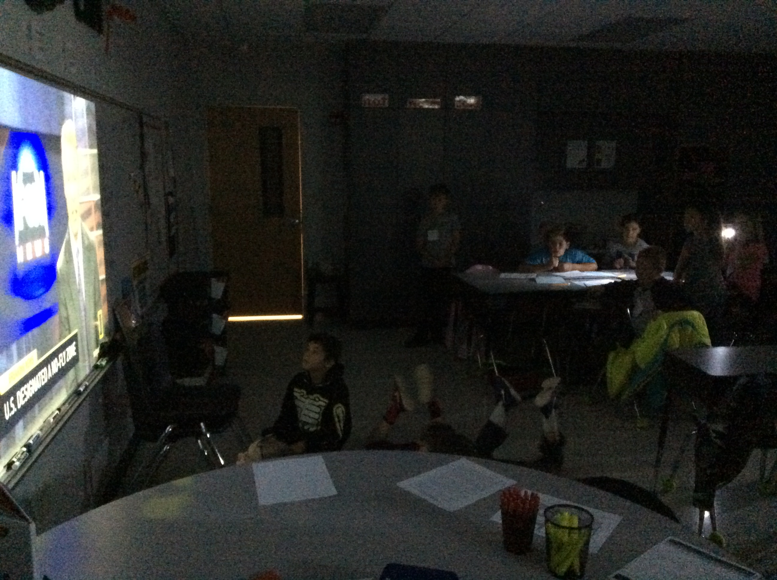 American Blackout Learning Experience: Students watch a news clip of what is taking place during the blackout.